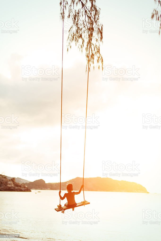 Boy on a rope swing stock photo