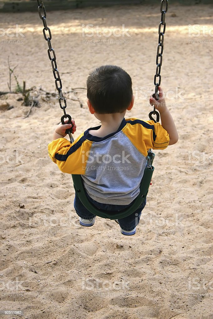 Boy On A Swing At The Park royalty-free stock photo