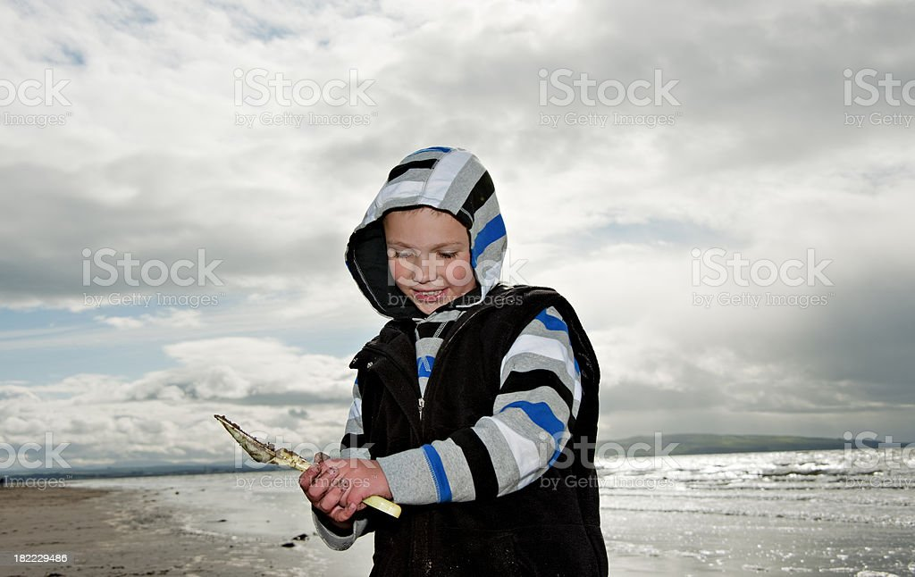 boy on beach royalty-free stock photo