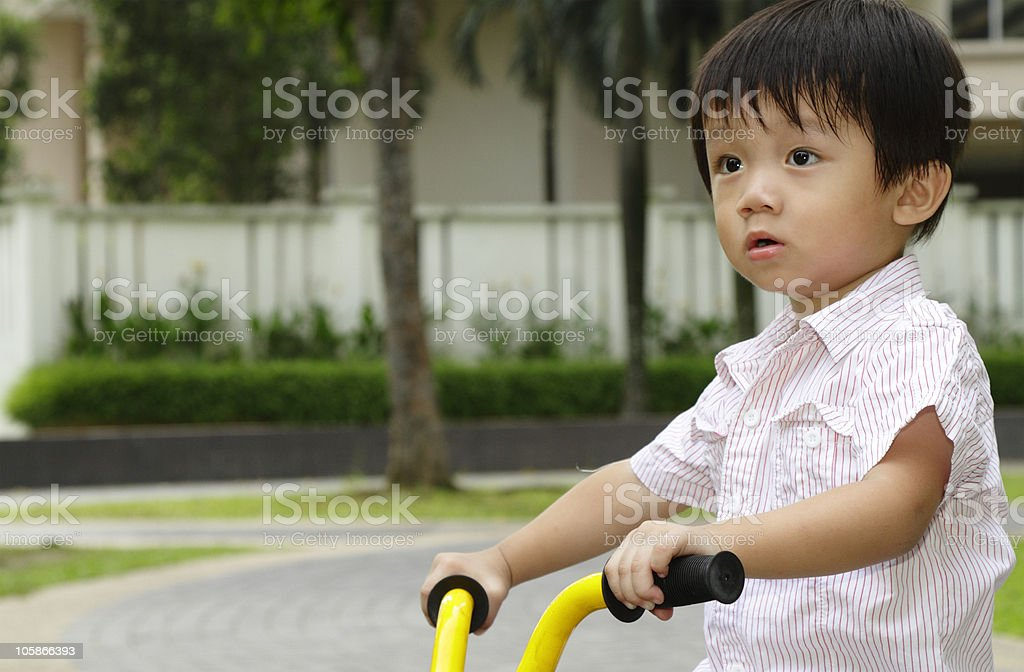 Boy on bicycle royalty-free stock photo
