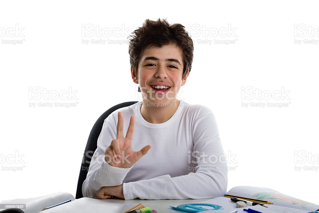 boy on blank book smiling and showing number 3 gesture stock photo