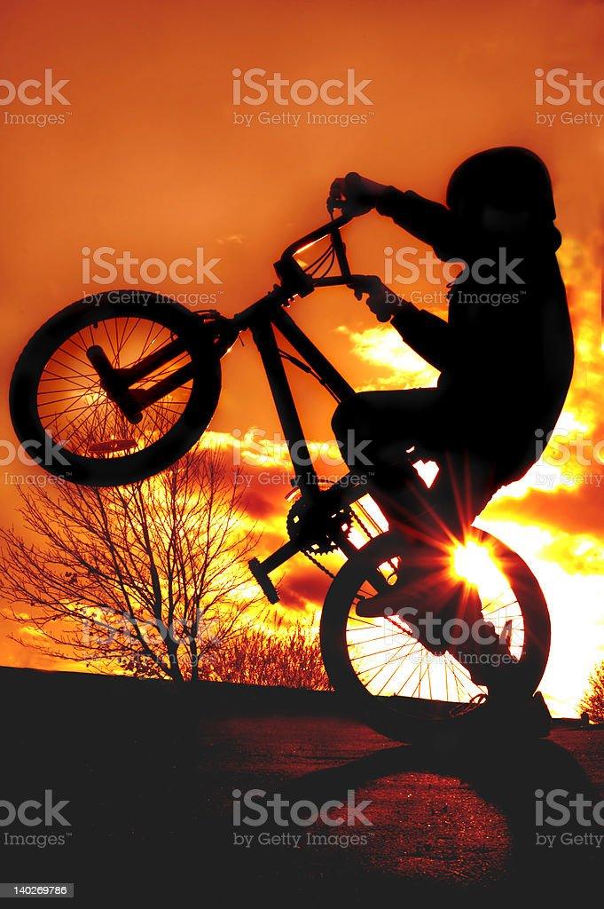 Boy on BMX silhouette royalty-free stock photo