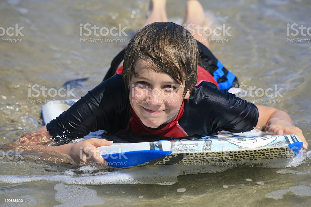Boy on Boogy Board, Cabarete, Dominican Republic stock photo