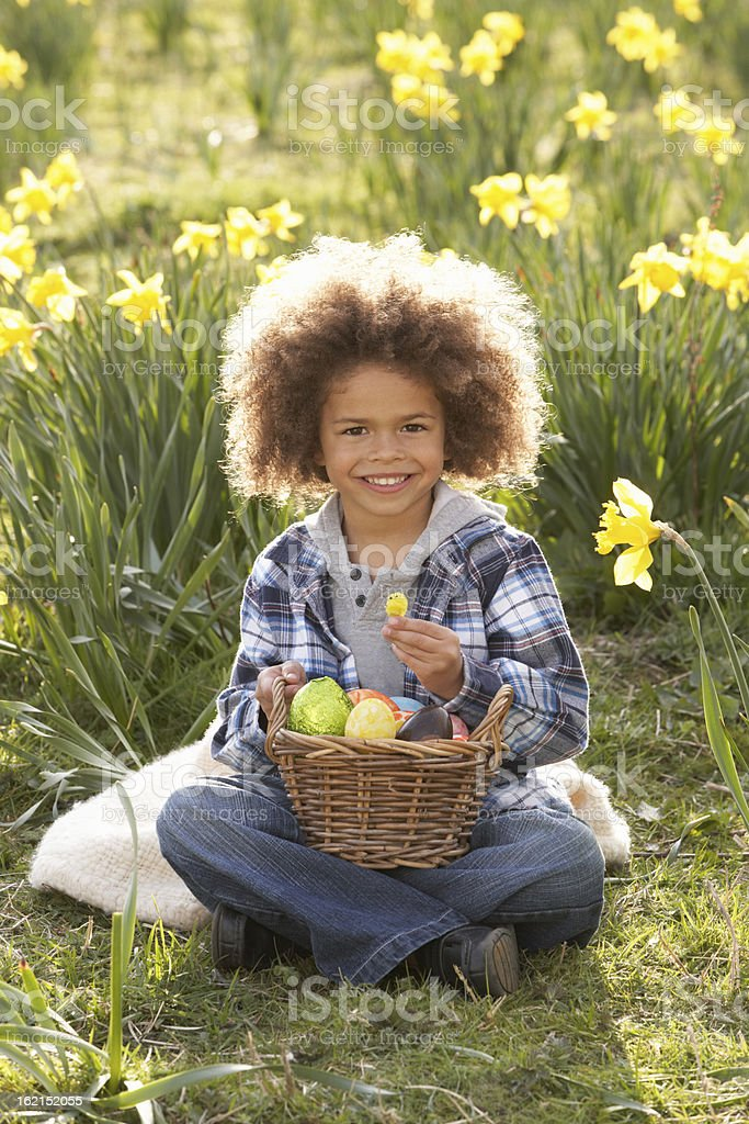 Boy On Easter Egg Hunt In Daffodil Field royalty-free stock photo