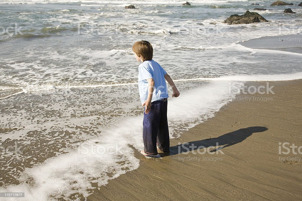Boy on Edge of water royalty-free stock photo
