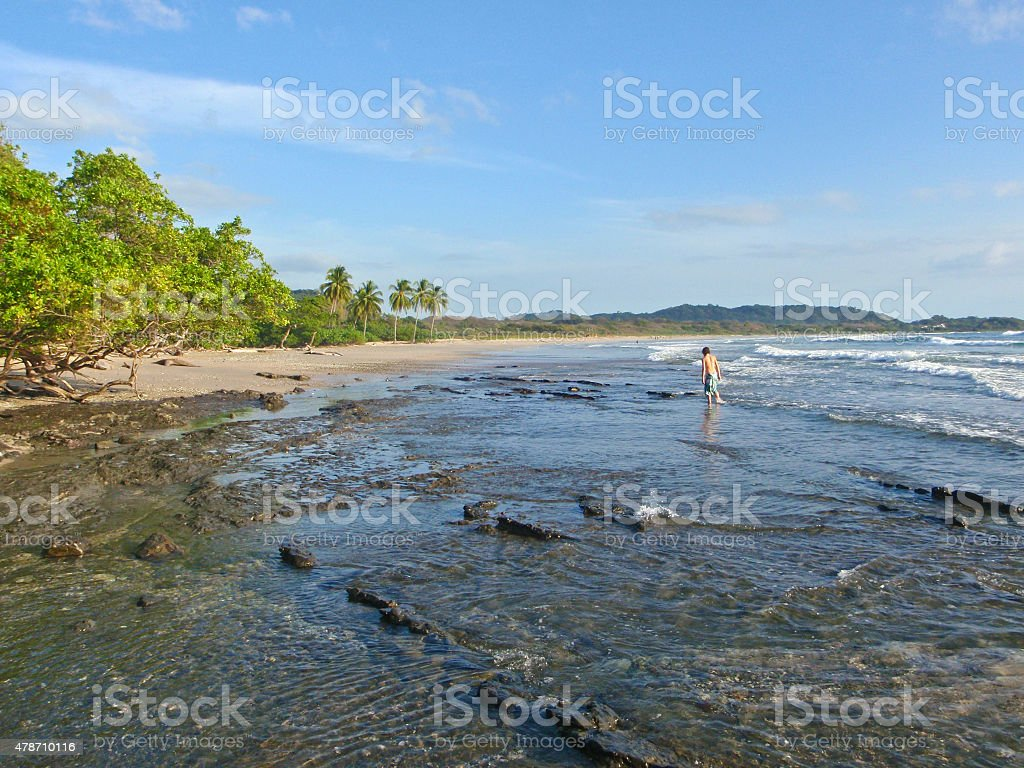 Boy on Guiones Beach stock photo