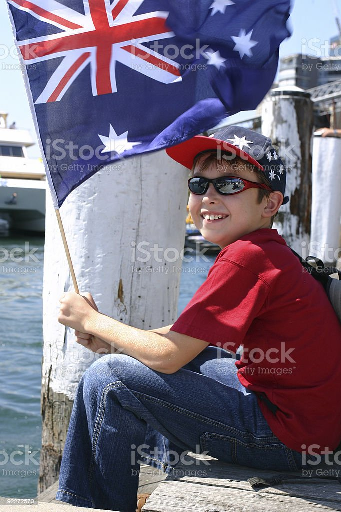 Boy on harbourside pier royalty-free stock photo