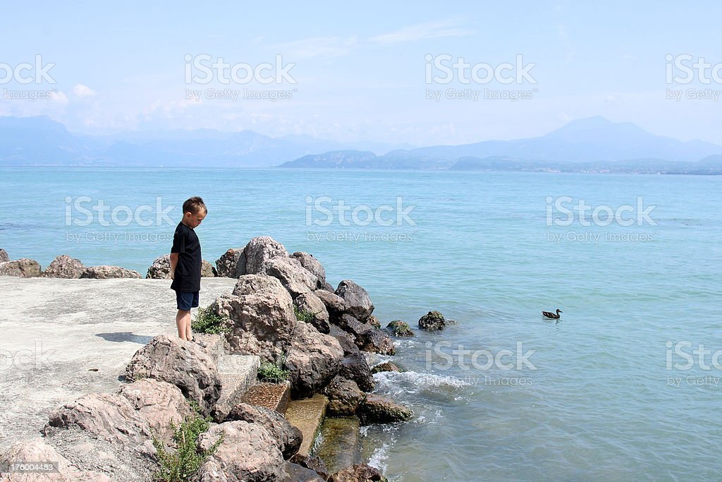 Boy on lake in Italy. stock photo