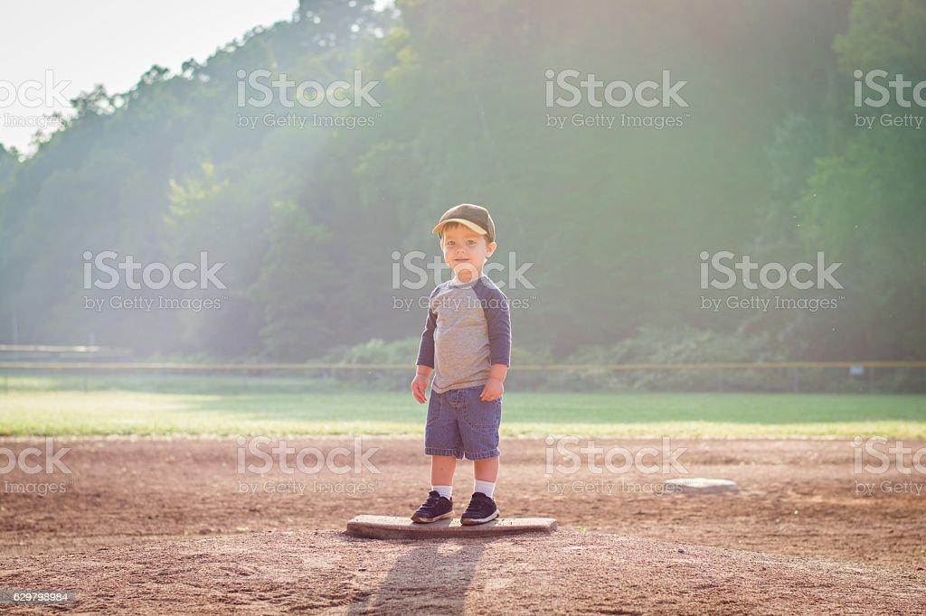 Boy on Pitcher's Mound stock photo