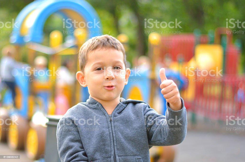 Boy on playground. stock photo