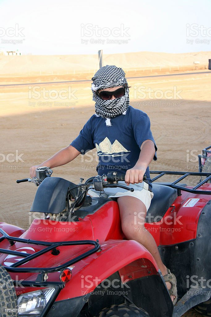 Boy on Quadbike stock photo
