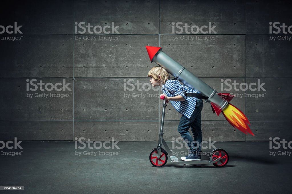 Boy on scooter stock photo