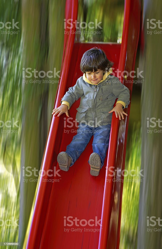 Boy on Slide royalty-free stock photo