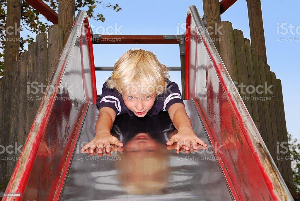 boy on slide stock photo
