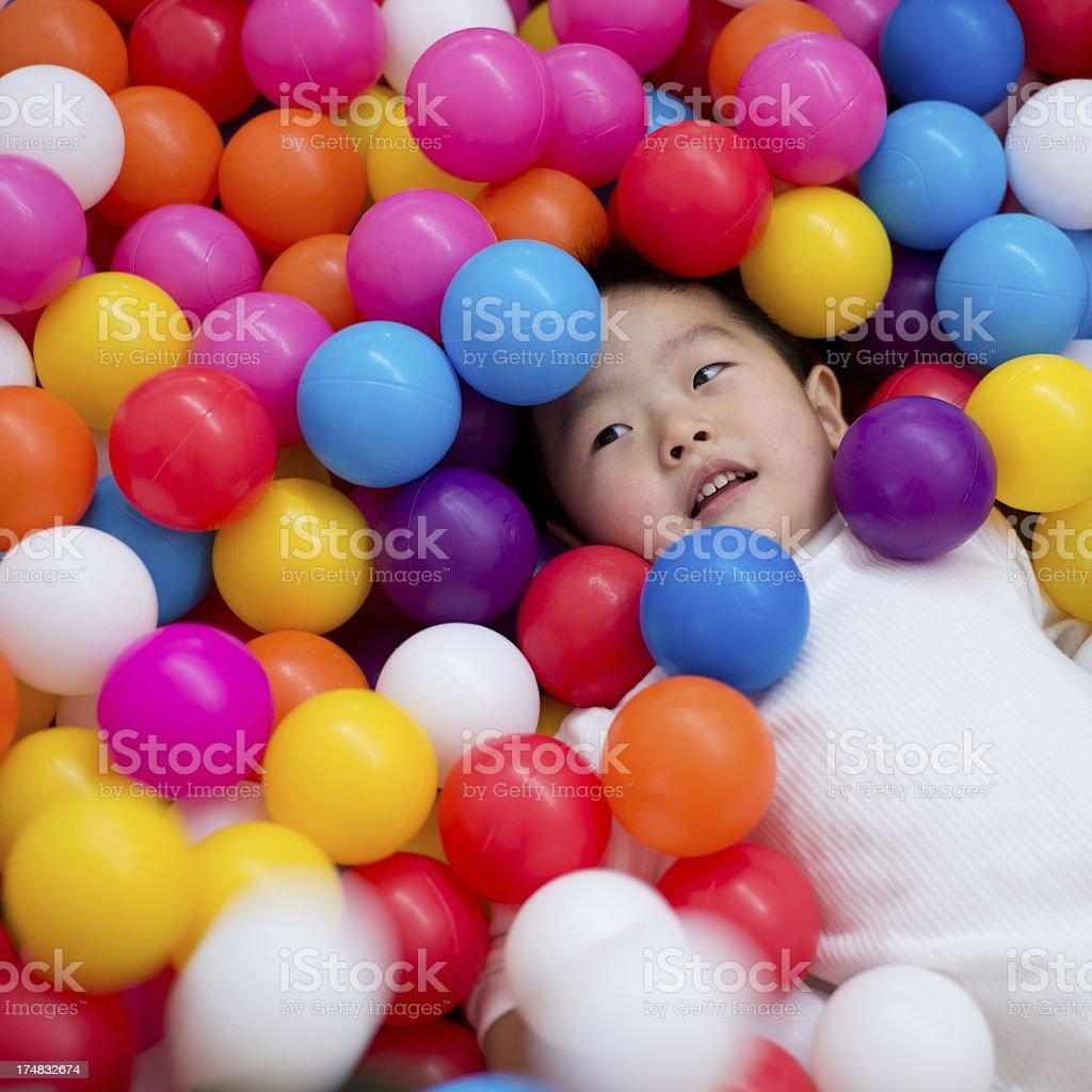 boy on the balls royalty-free stock photo