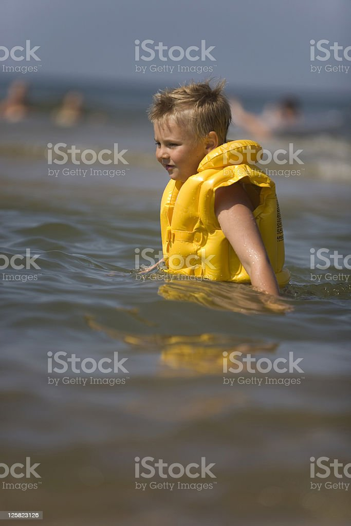 Boy on the beach royalty-free stock photo