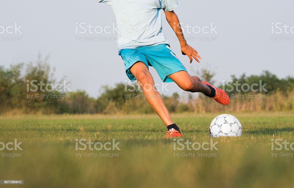 Boy on the football training stock photo