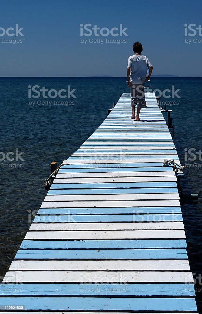 Boy on the pier royalty-free stock photo