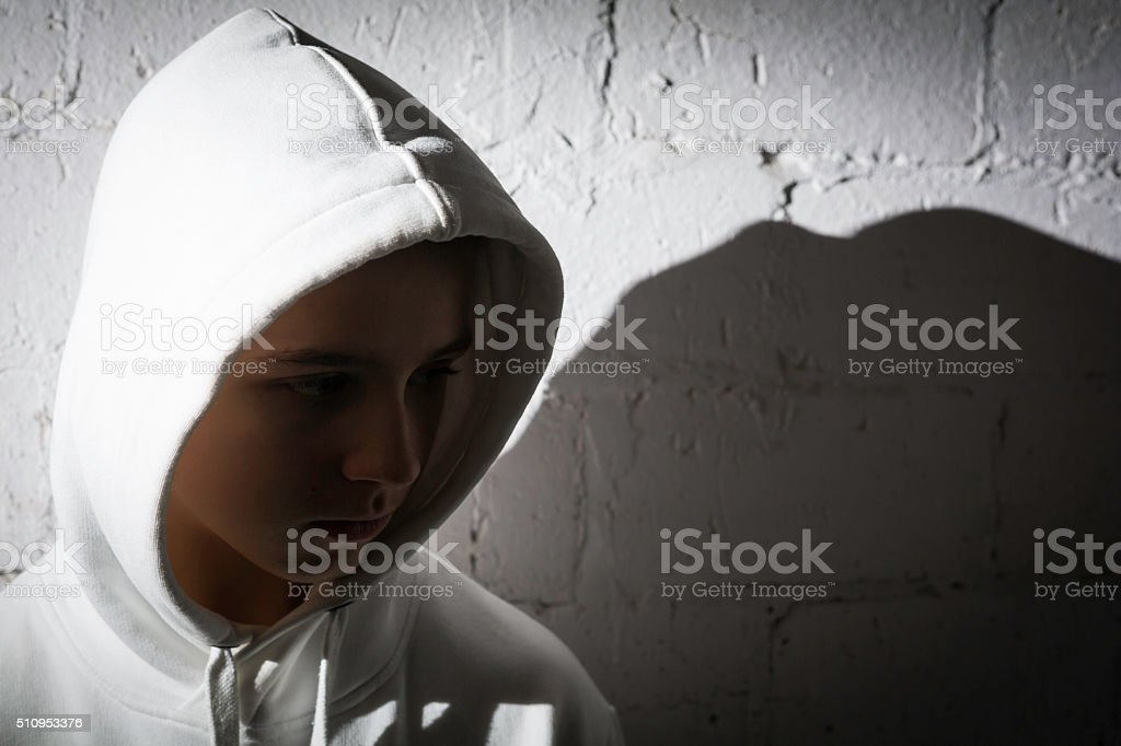boy on the wall stock photo