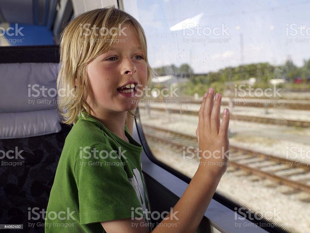 Boy on train stock photo