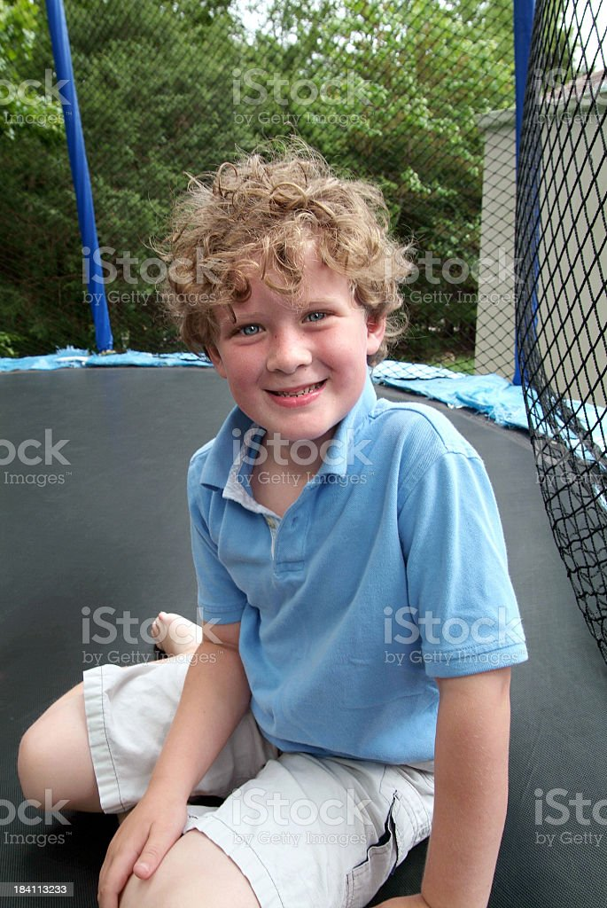 boy on trampoline stock photo