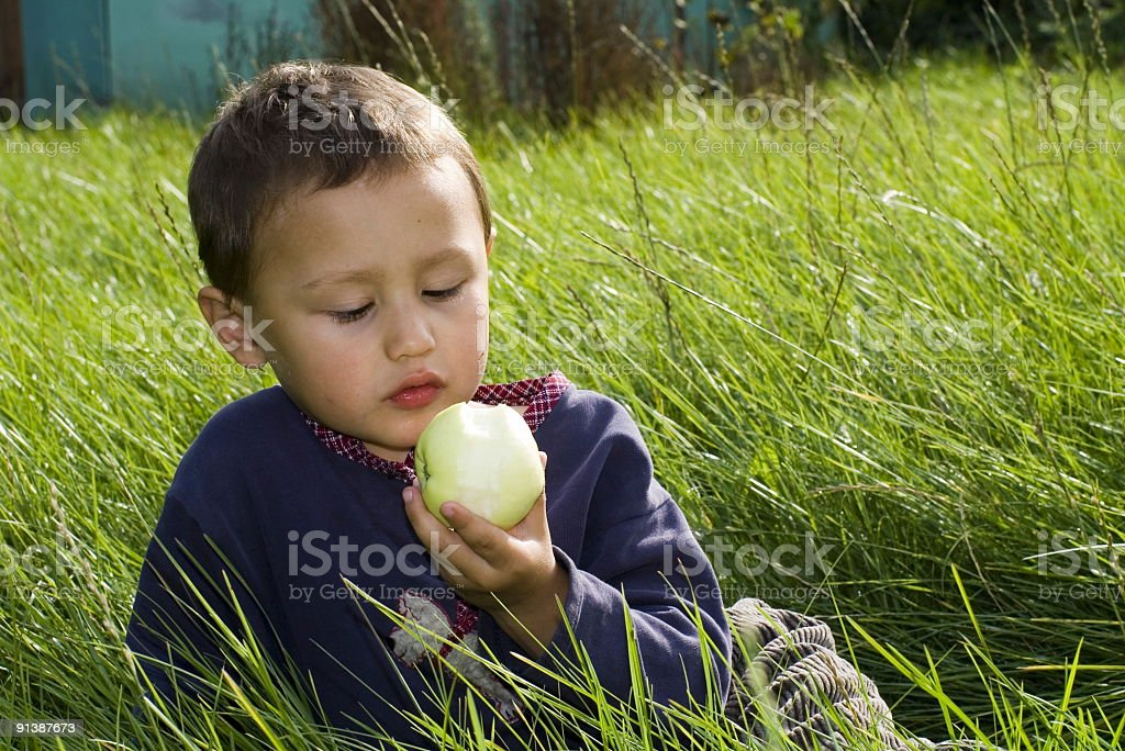 boy outdoors with apple royalty-free stock photo