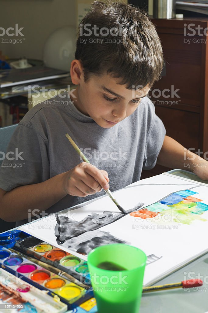 Boy painting with watercolors royalty-free stock photo