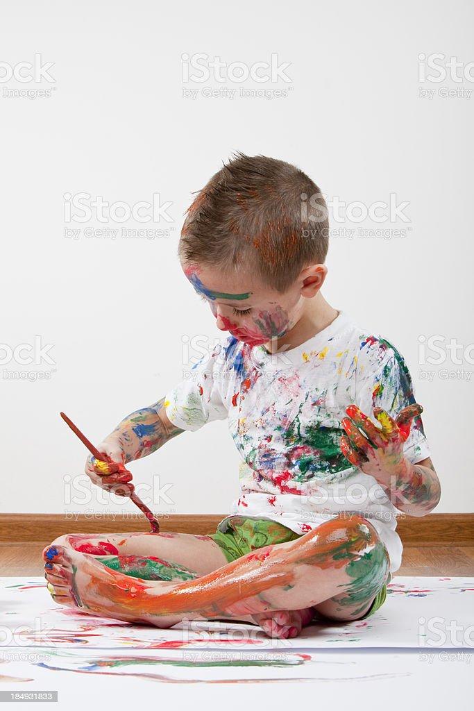 boy paints XXXL royalty-free stock photo