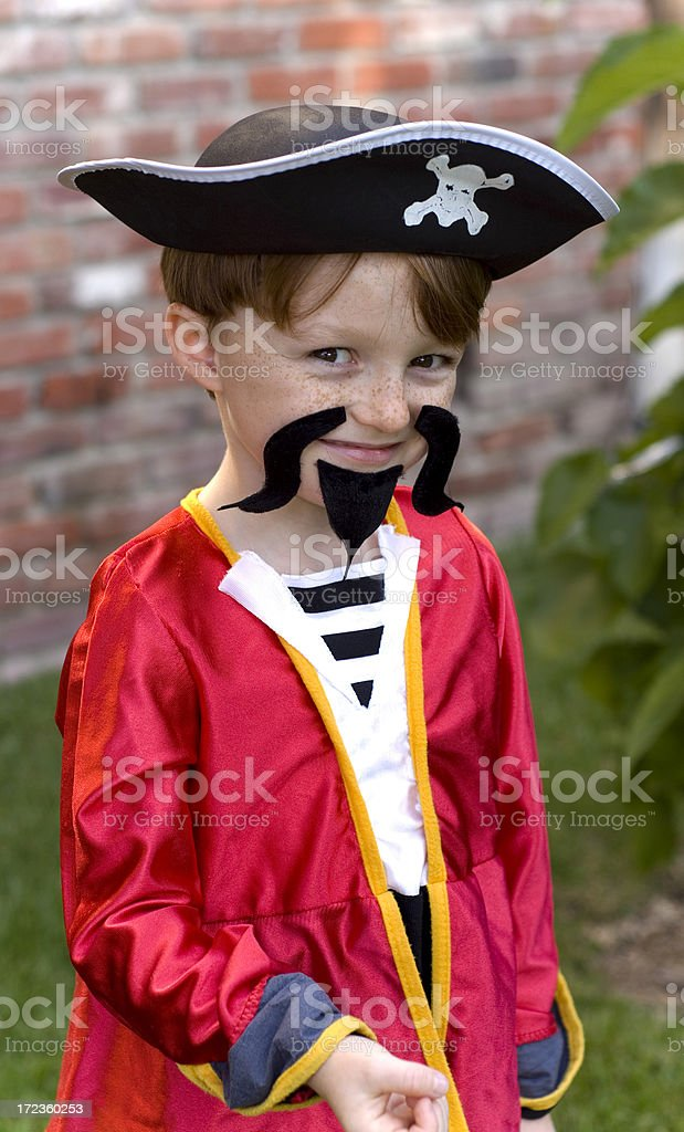 Boy Pirate Disguise, Child Redhead & Freckle Face in Halloween Costume royalty-free stock photo