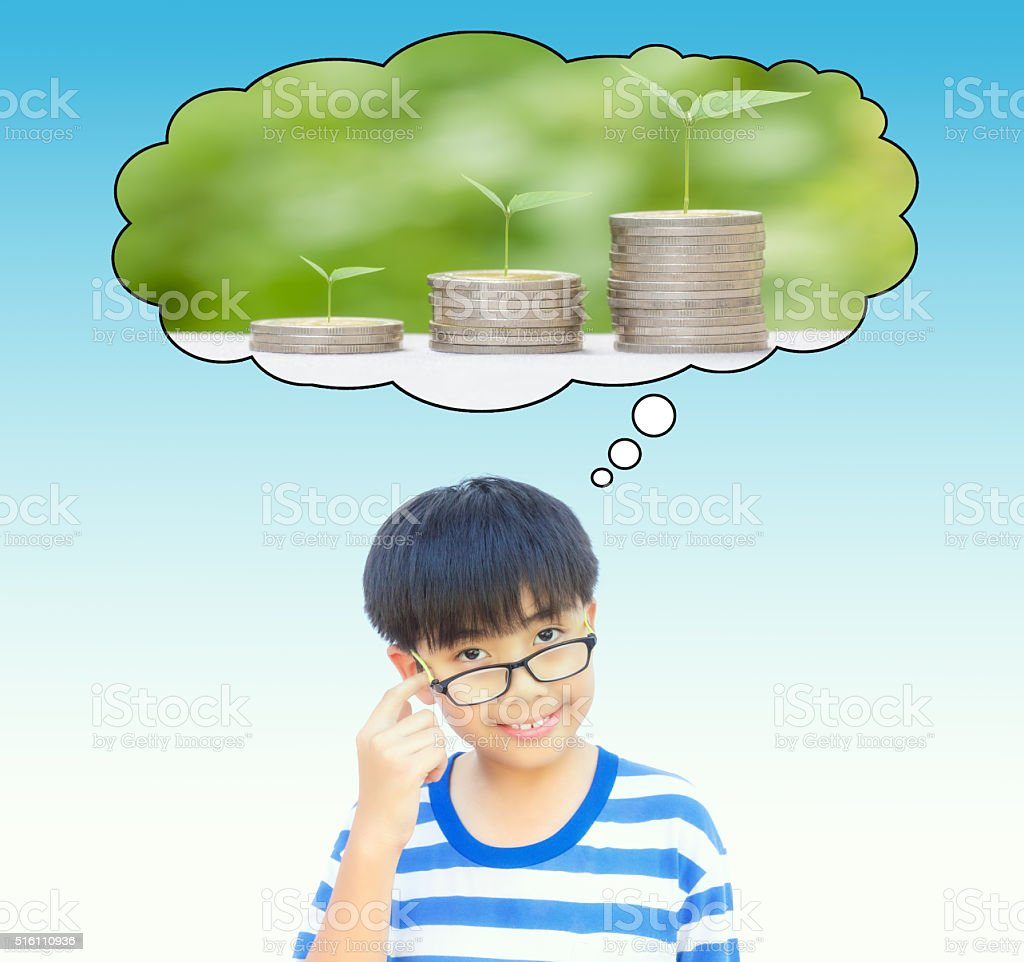 Boy planing for save money or growing business idea concept. stock photo