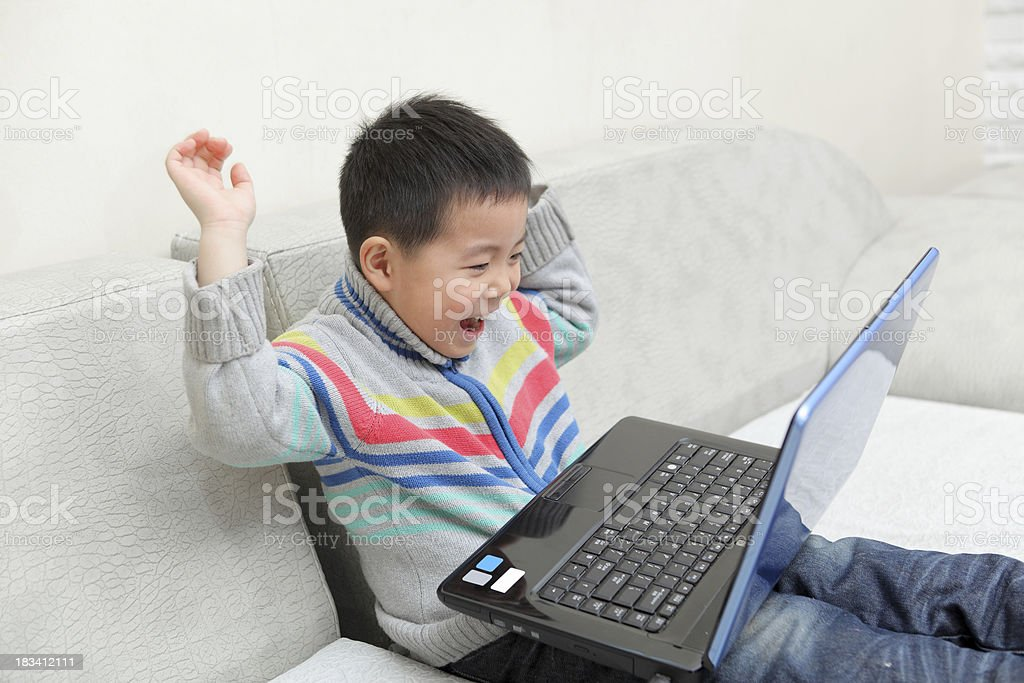 boy play laptop royalty-free stock photo