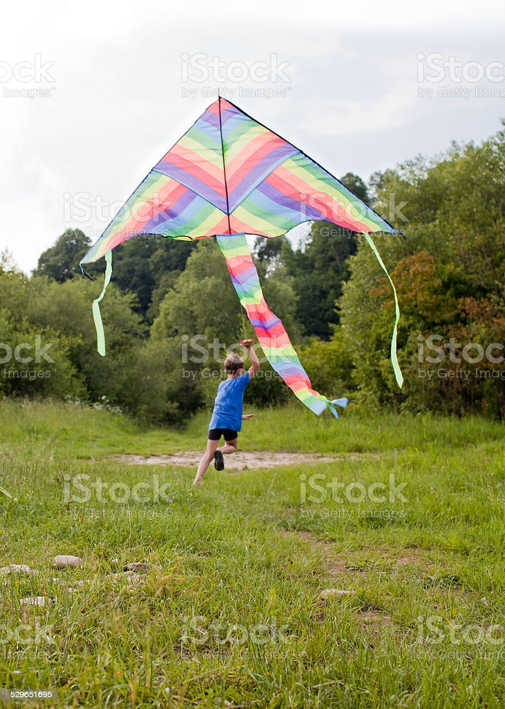 Boy play with kite stock photo
