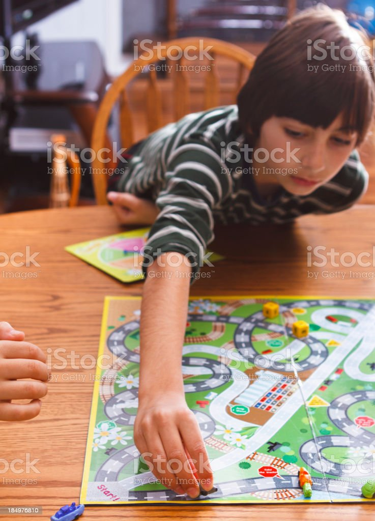Boy Playing A Board Game royalty-free stock photo
