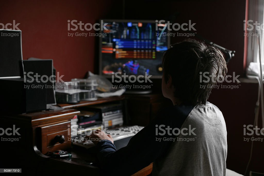 Boy playing a PC Game stock photo