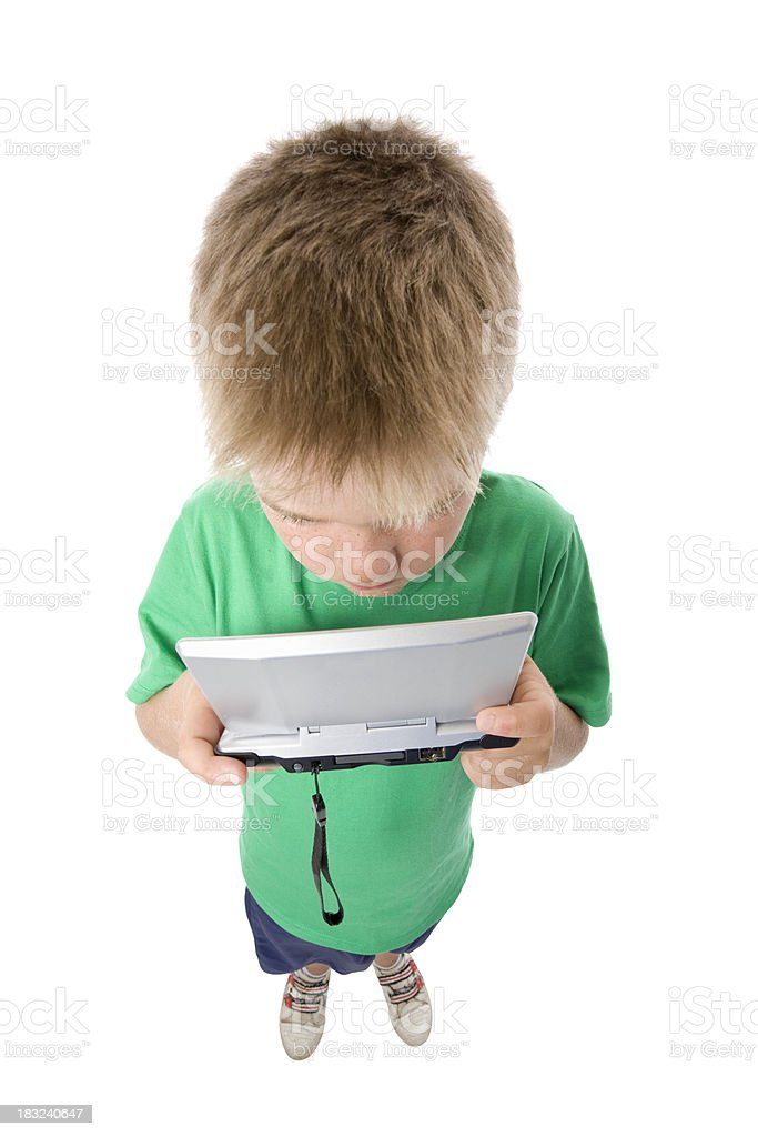 Boy playing an electronic game. royalty-free stock photo