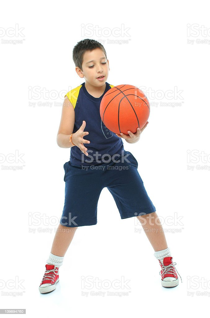 Boy playing basketball isolated stock photo