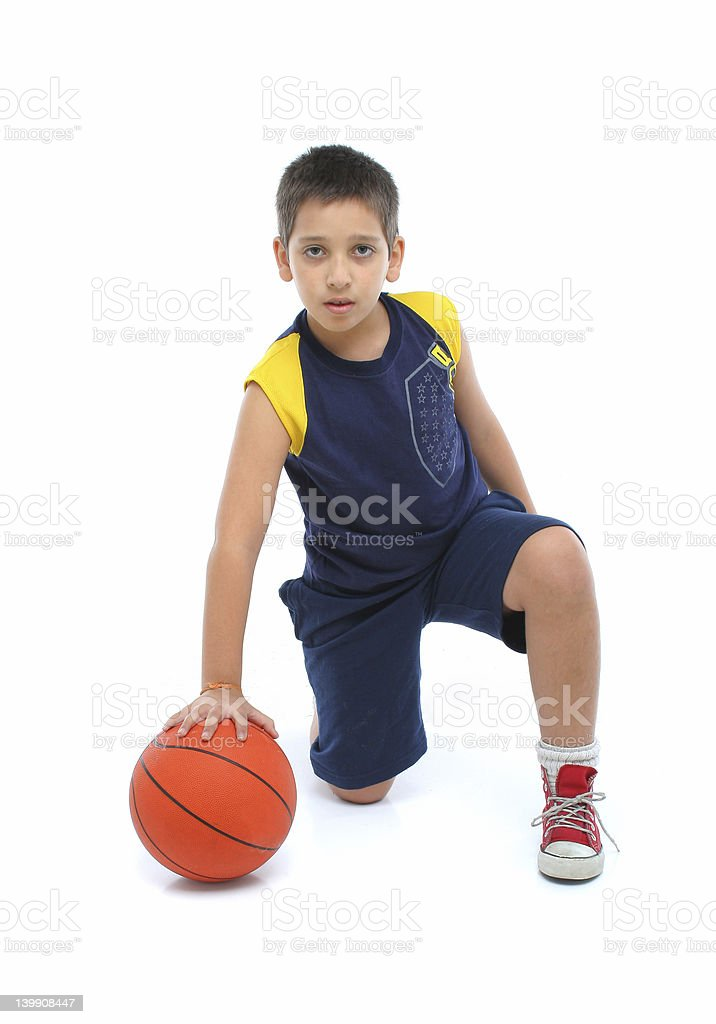 Boy playing basketball isolated royalty-free stock photo