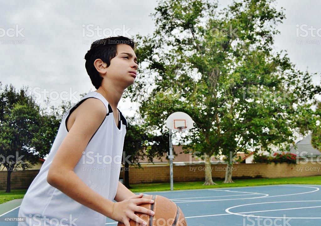 Boy Playing Basketball stock photo