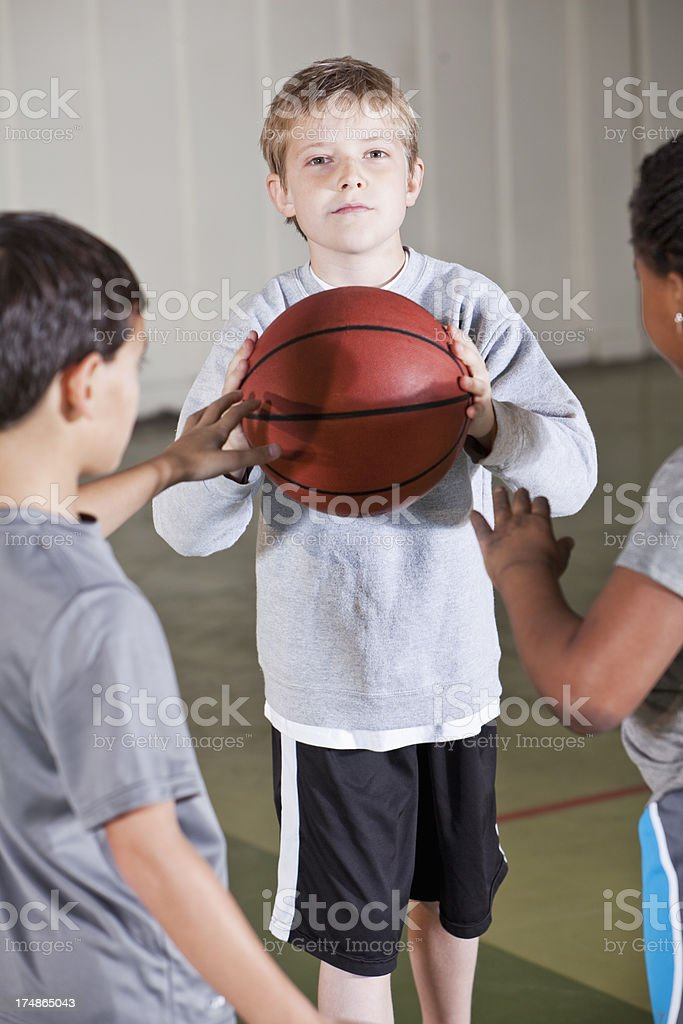 Boy playing basketball with friends royalty-free stock photo