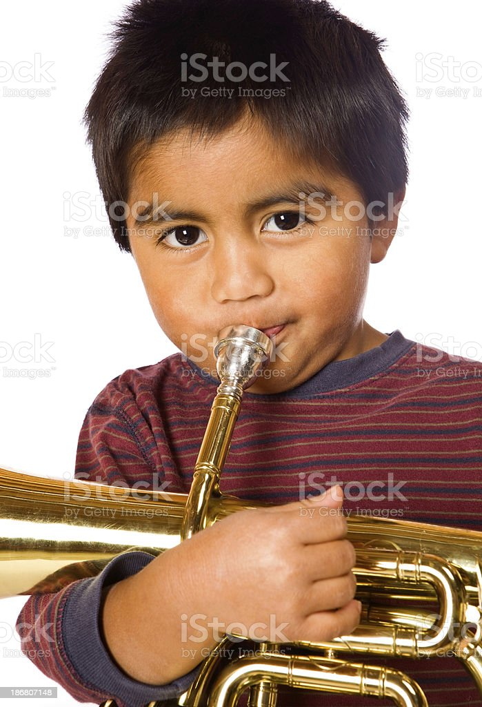 Boy Playing Brass Horn stock photo