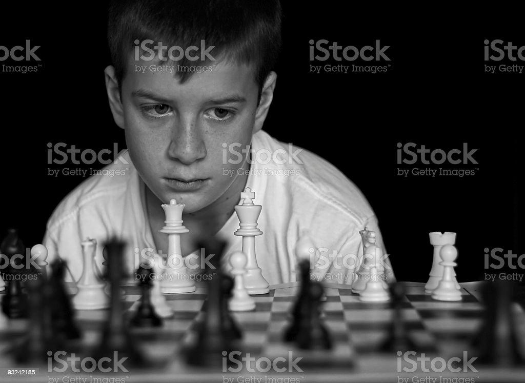 Boy Playing Chess - B&W royalty-free stock photo
