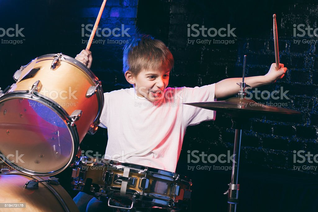 Boy playing drums stock photo