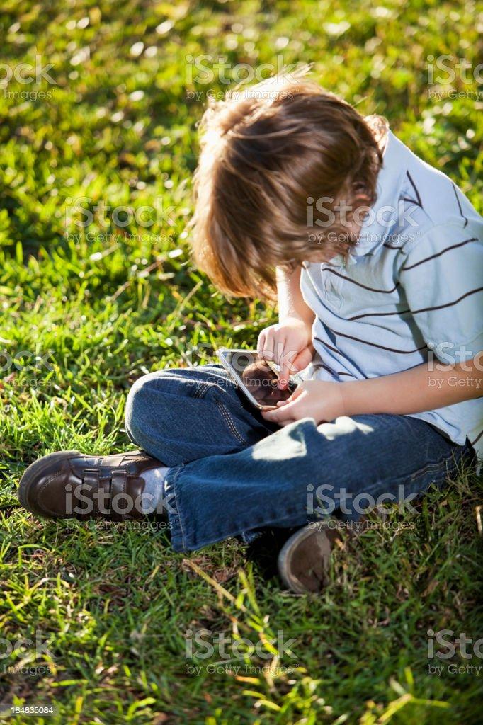 Boy playing electronic game royalty-free stock photo