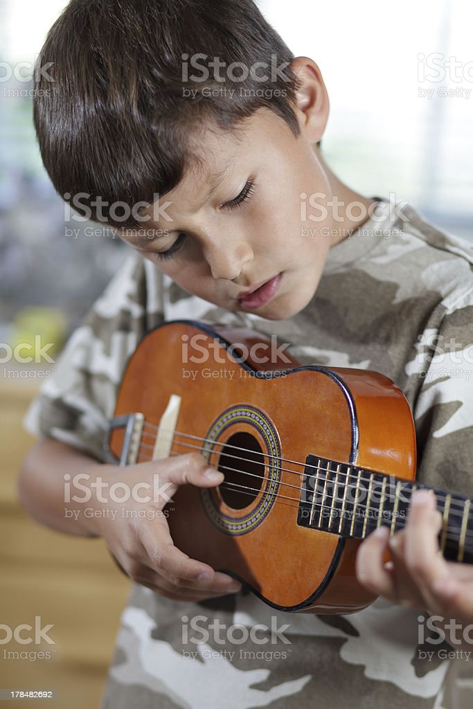 Boy playing guitar royalty-free stock photo