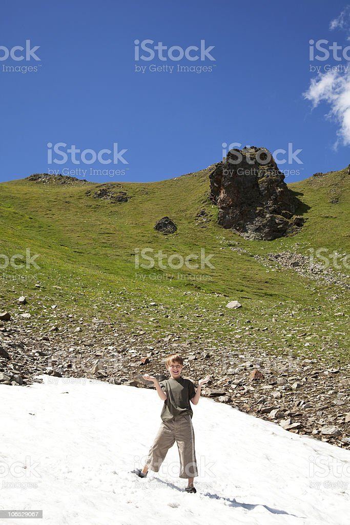 boy playing in a snowfield royalty-free stock photo