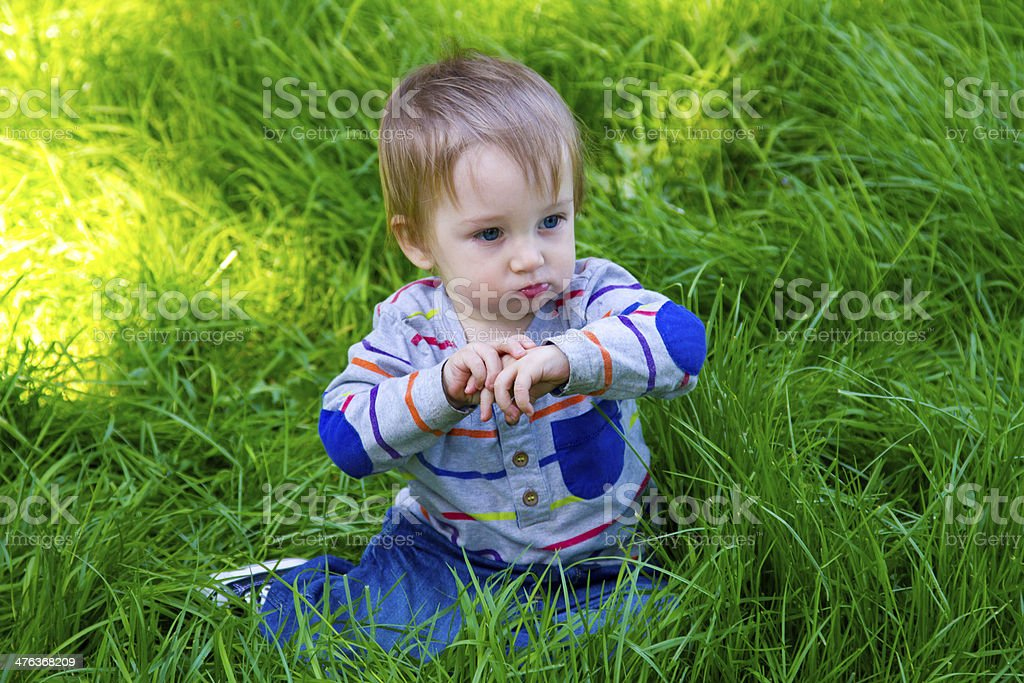 Boy Playing in Grass royalty-free stock photo