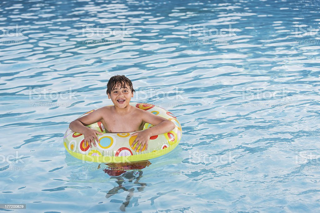 Boy playing in swimming pool. royalty-free stock photo