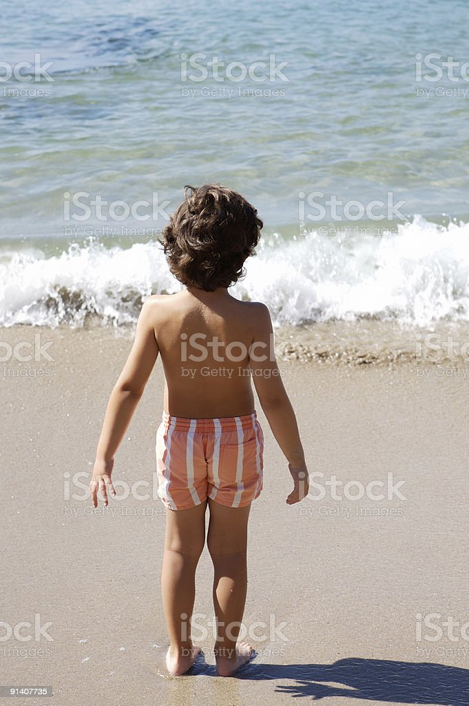 boy playing in the beach royalty-free stock photo