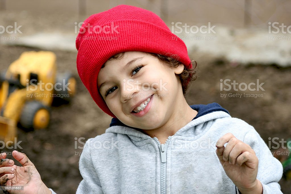 Boy Playing in the Dirt stock photo