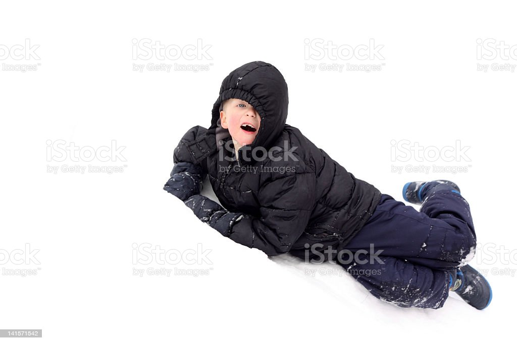 Boy Playing In The Snow stock photo